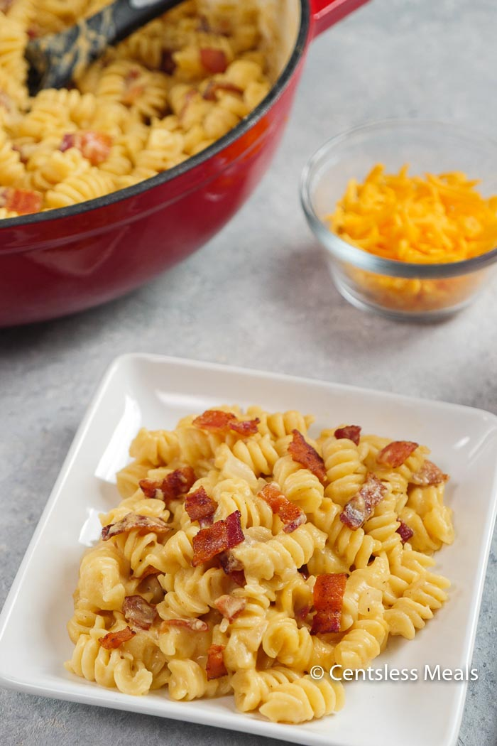This Beer Cheese Macaroni recipe gets rave reviews every time! Creamy, cheesy, and totally irresistible! Smoky crisp bacon is the perfect topper for this mac & cheese recipe!
