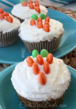 Carrot cake cupcakes on plates with M&M's on top