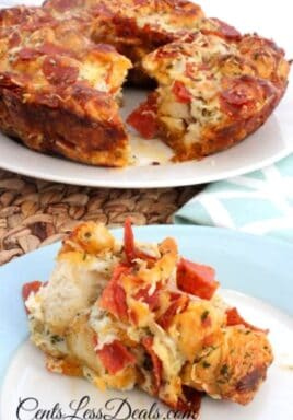 Pizza pull-apart bread on a plate with the rest on a plate in the background