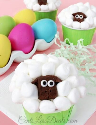 Sheep cupcakes with colorful eggs on the side