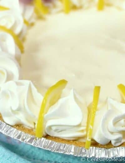 Creamy lemon pie with whipped cream and lemon slices