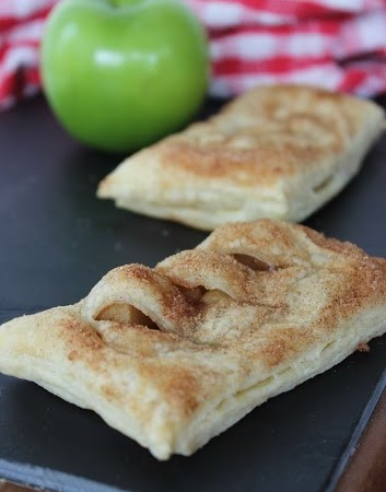 Copycat McDonald's apple pies with an apple in the background