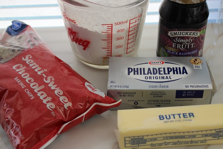 Ingredients for black raspberry chocolate chip cheese ball on the countertop