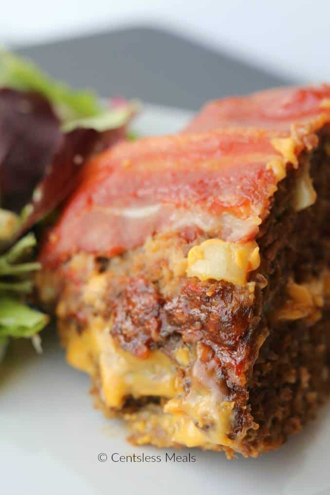 Bacon Cheeseburger Meatloaf takes your basic meatloaf recipe and kicks it up a notch! Adding bacon, potato chips and even pickles takes this meatloaf from plain and ordinary to exceptional!