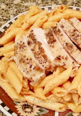 Tomato Cream Sauce Pasta with Grilled Chicken on a plate