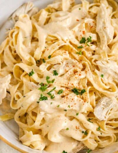 Cajun chicken alfredo in a bowl garnished with parsley