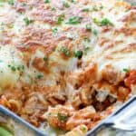 Sour cream noodle bake in a clear casserole dish with a scoop taken out