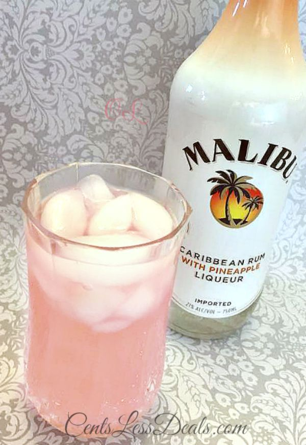 Bottle of Malibu liqueur next to a glass of sassy lemonade