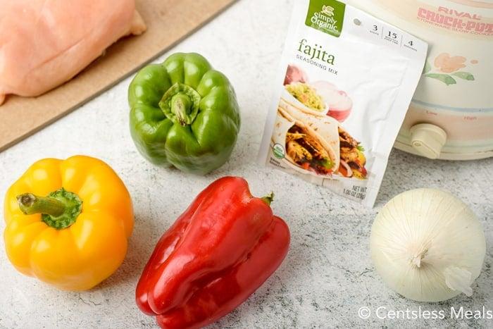 Ingredients for Crock-Pot chicken fajitas on a marble board