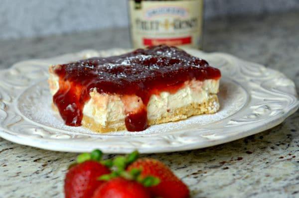 No Bake Strawberry Cheesecake Bars recipe Sponsored by Smucker's®