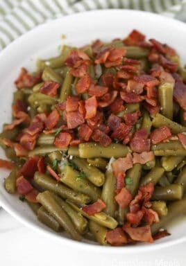 Texas Roadhouse green beans in a white bowl with bacon