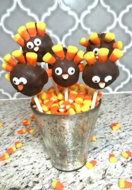 Thanksgiving turkey Pops in a dish with candy corn