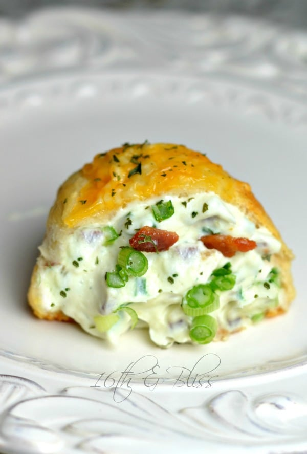 Bacon cream cheese bomb on a white plate garnished with parsley