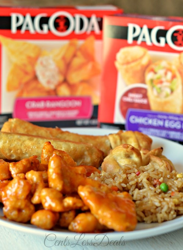 Orange chicken recipe on a plate with rice and spring rolls and Pagoda packages in the background