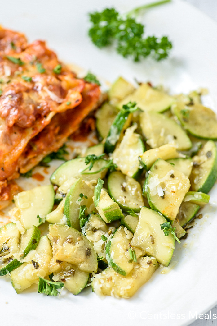 Close up of parmesan zucchini served with lasagna.