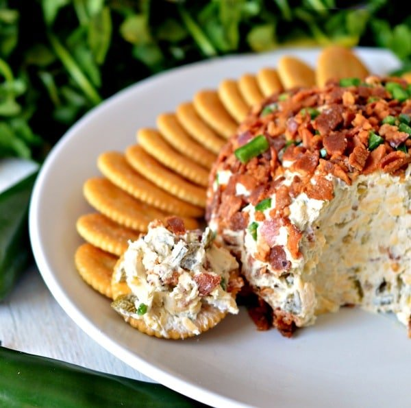 Bacon jalapeno cheese ball on a plate with crackers