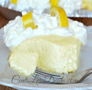 Creamy lemon pie on a plate with a fork