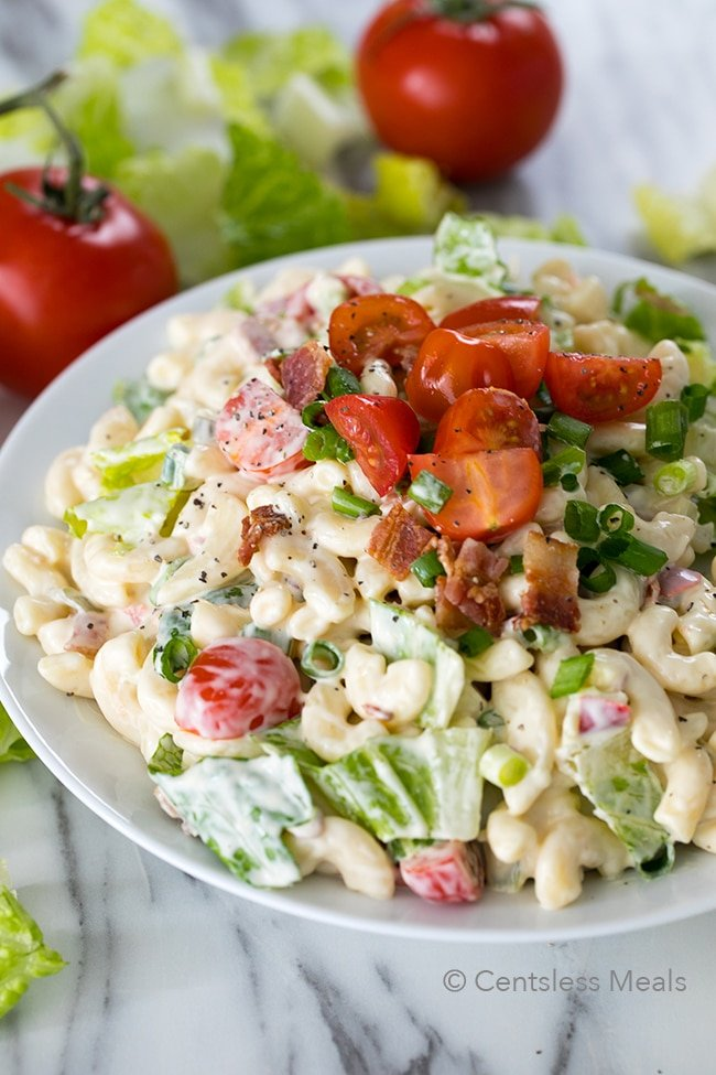 BLT Pasta Salad is a potluck favorite, and loaded with delicious flavors. Tender pasta is tossed with crisp salty bacon, ripe juicy tomatoes and crunchy romaine for a pasta salad your family is going to love!