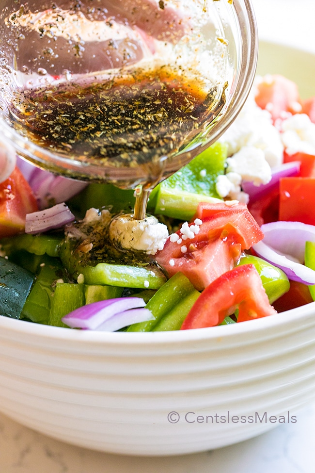 An easy Greek Salad loaded with ripe juicy tomatoes, crisp cucumbers and creamy feta cheese all tossed in a simple homemade dressing is the perfect side for your summer grilling!