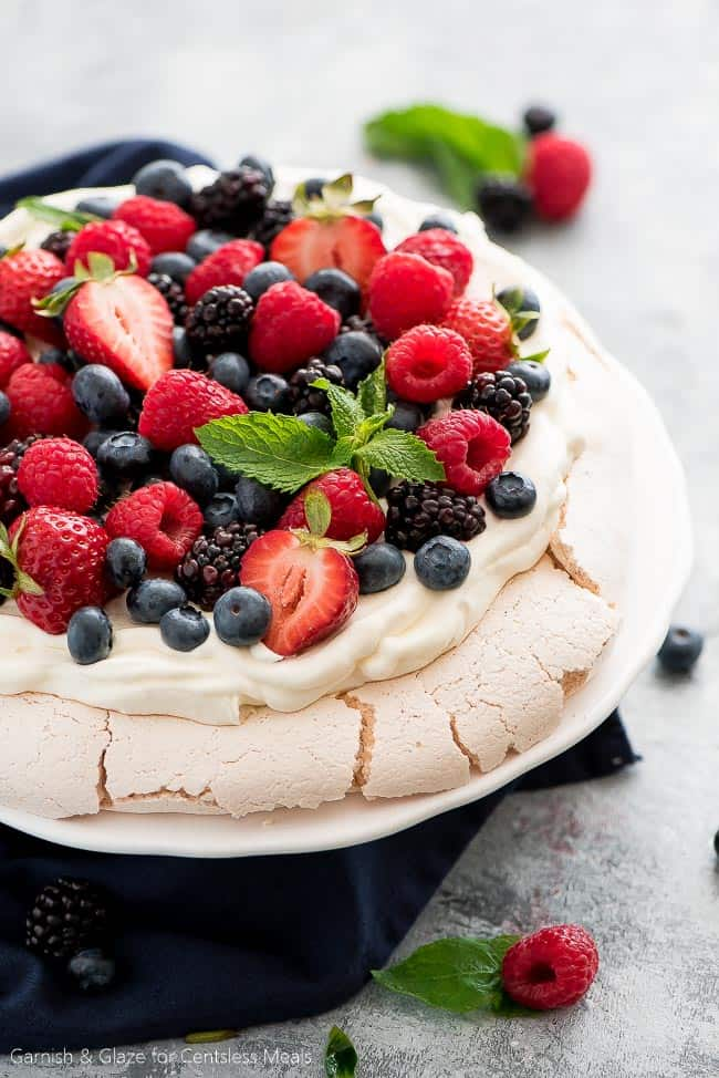 For a simple, beautiful, and refreshing dessert this summer, make this Berry Topped Pavlova!