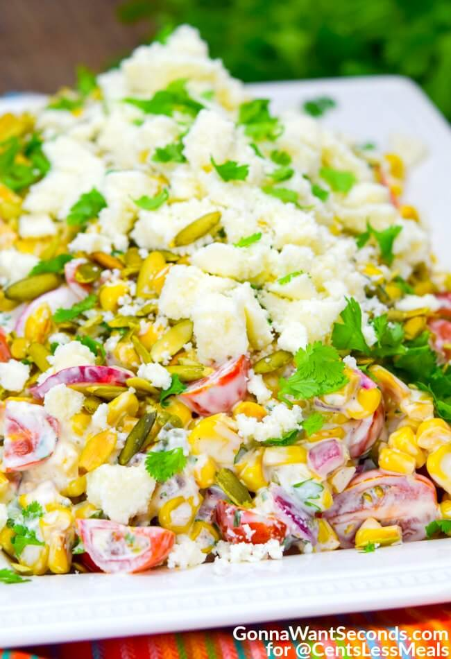 Mexican Corn Salad combines fresh veggies with a creamy cilantro cayenne dressing and topped with cotija to create a fiesta in every bite!