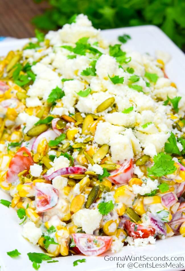 Mexican Corn Salad combines fresh veggies with a creamy cilantro cayenne dressing and topped with crumbled cotija to create a flavourful fiesta in every bite!
