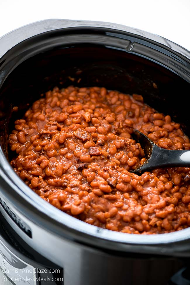 These Slow Cooker Baked Beans are made from scratch. They're easy, delicious and loaded with bacon, and are the perfect side for a barbecue.