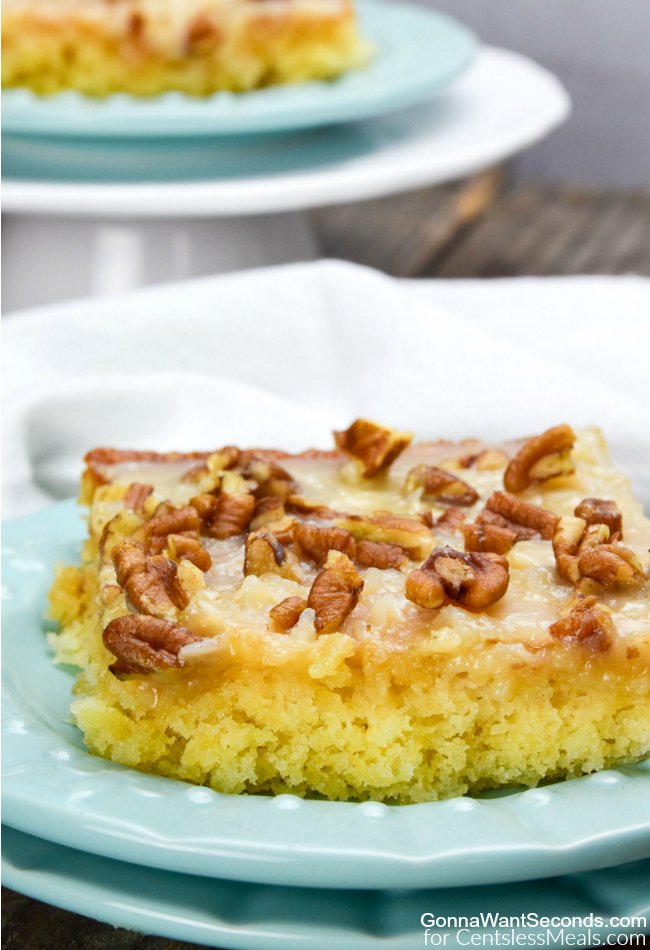 Pineapple Sheet Cake on a blue plate with pecans on top