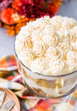 Caramel apple trifle in a trifle dish topped with whipped cream