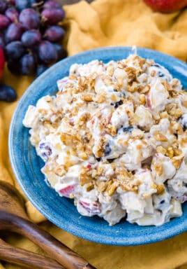 Apple walnut salad in a blue Bowl