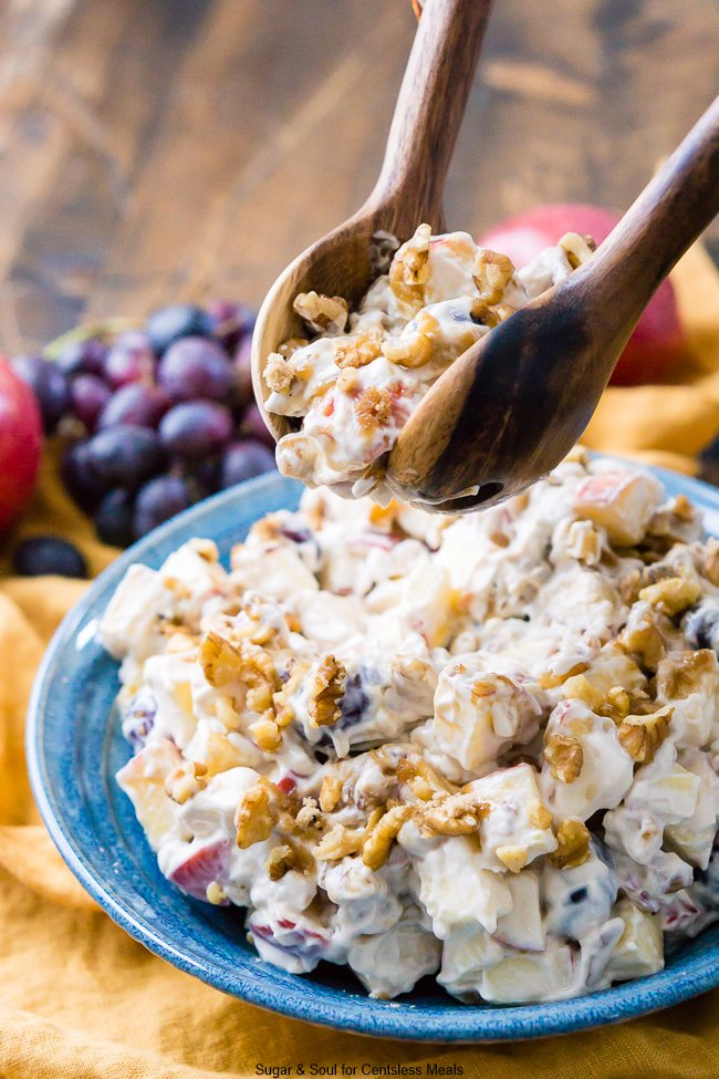 This Apple Walnut Salad is made with cream cheese, yogurt, apples, grapes, walnuts, and sugar! A fresh and delicious salad your family will love!