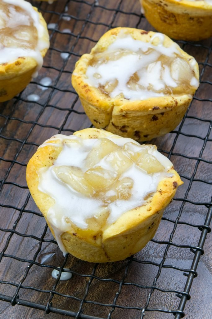 2 Ingredient Apple Pie Cups on a cooling rack with icing