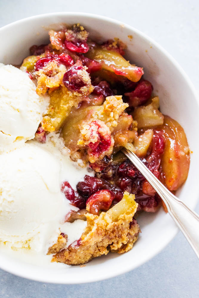 This Apple Cranberry Crisp is made with apples, sweet cranberries and streusel topping. What a delicious festive dessert!