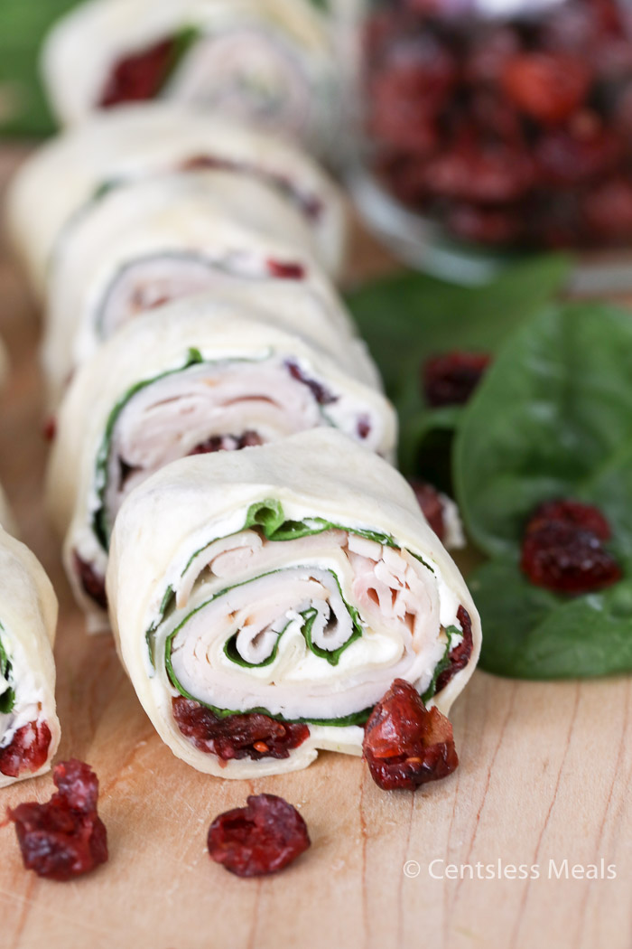 Turkey Cranberry Pinwheels combine your favorite festive trimmings like turkey and cranberries all encased in a snug, tortilla blanket. Such a festive appetizer for this holiday season!