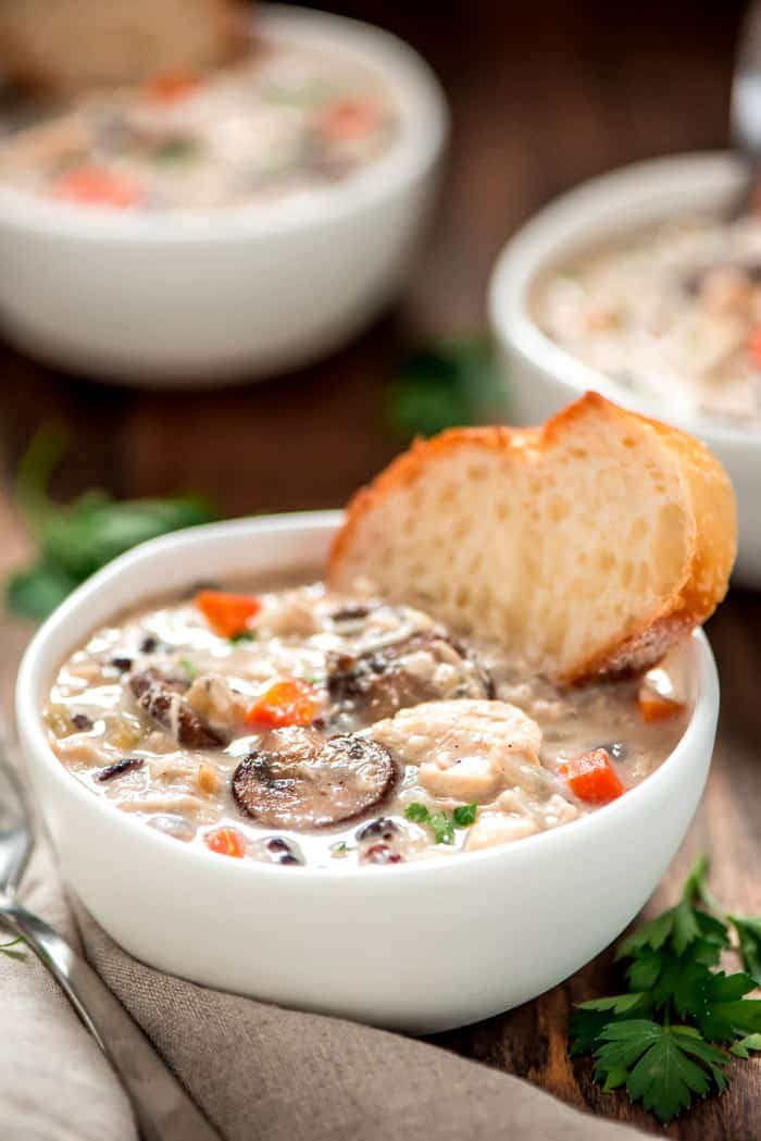Warm up this winter with a bowl of creamy Slow Cooker Chicken Wild Rice Soup. It's easy, simple, comforting, and even loaded with lots of veggies.