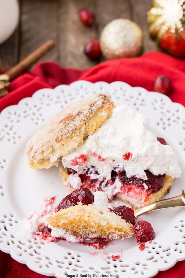 This Cranberry Shortcake is a delectable dessert made with juicy, sweet-tart cranberries, flaky buttermilk biscuits, and topped with a dollop of whipped cream.