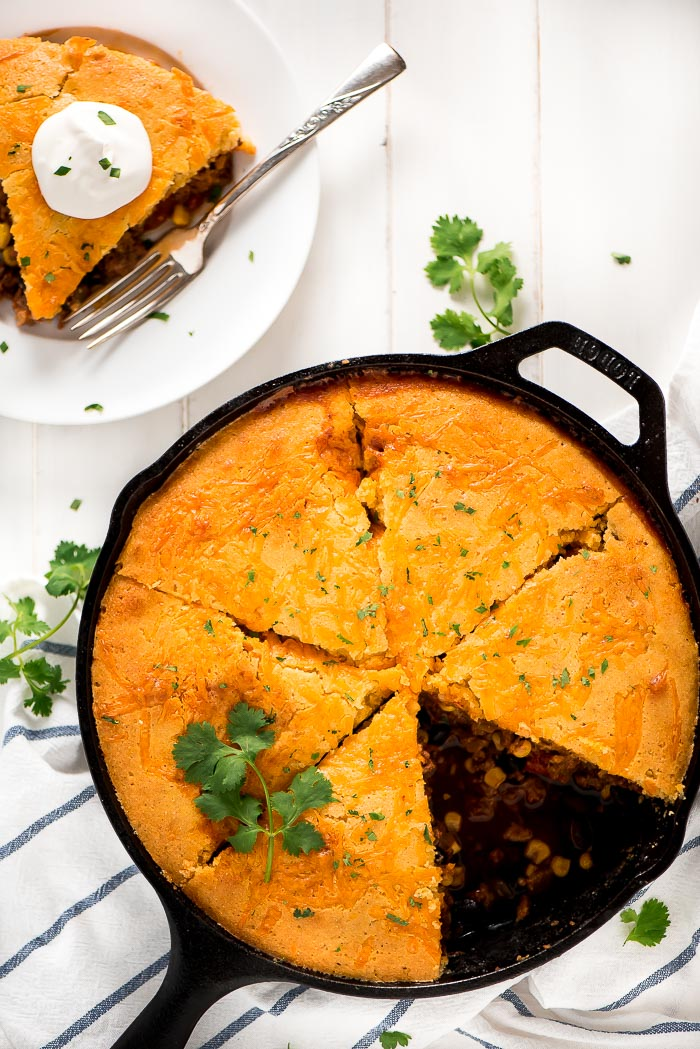 This Tamale Pie has all the same things that are in tacos or tamales such as meat, beans, cheese, and veggies only this recipe is in pie form.