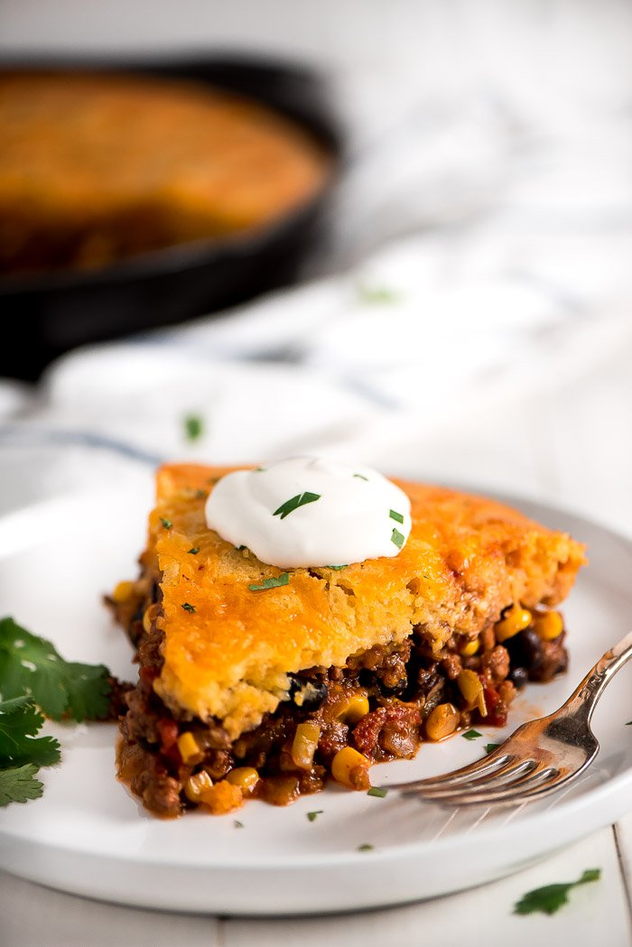Tamale Pie is a delicious, sweet and savory, comforting meal that is loaded with meat, beans, cheese, and veggies with cornbread on top. It's sure to be a family favorite!