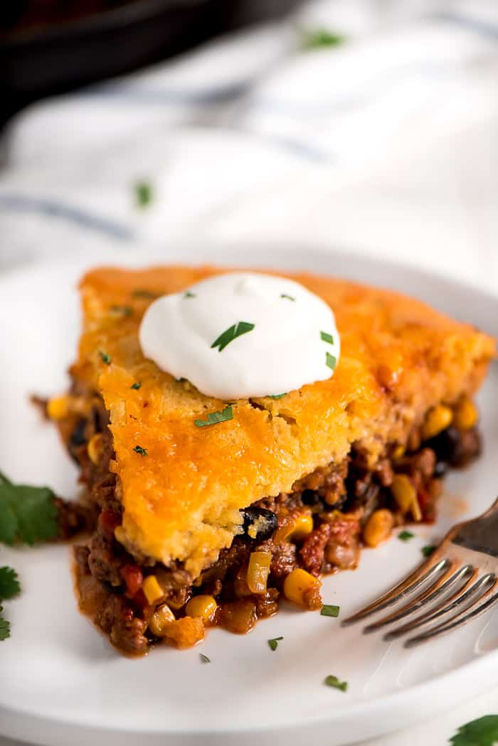 This one dish Tamale Pie starts with browned beef, onion and garlic, black beans, corn, tomatoes, green chilies, tomato paste, seasonings and cheese. Top it off with cornbread...so delicious!
