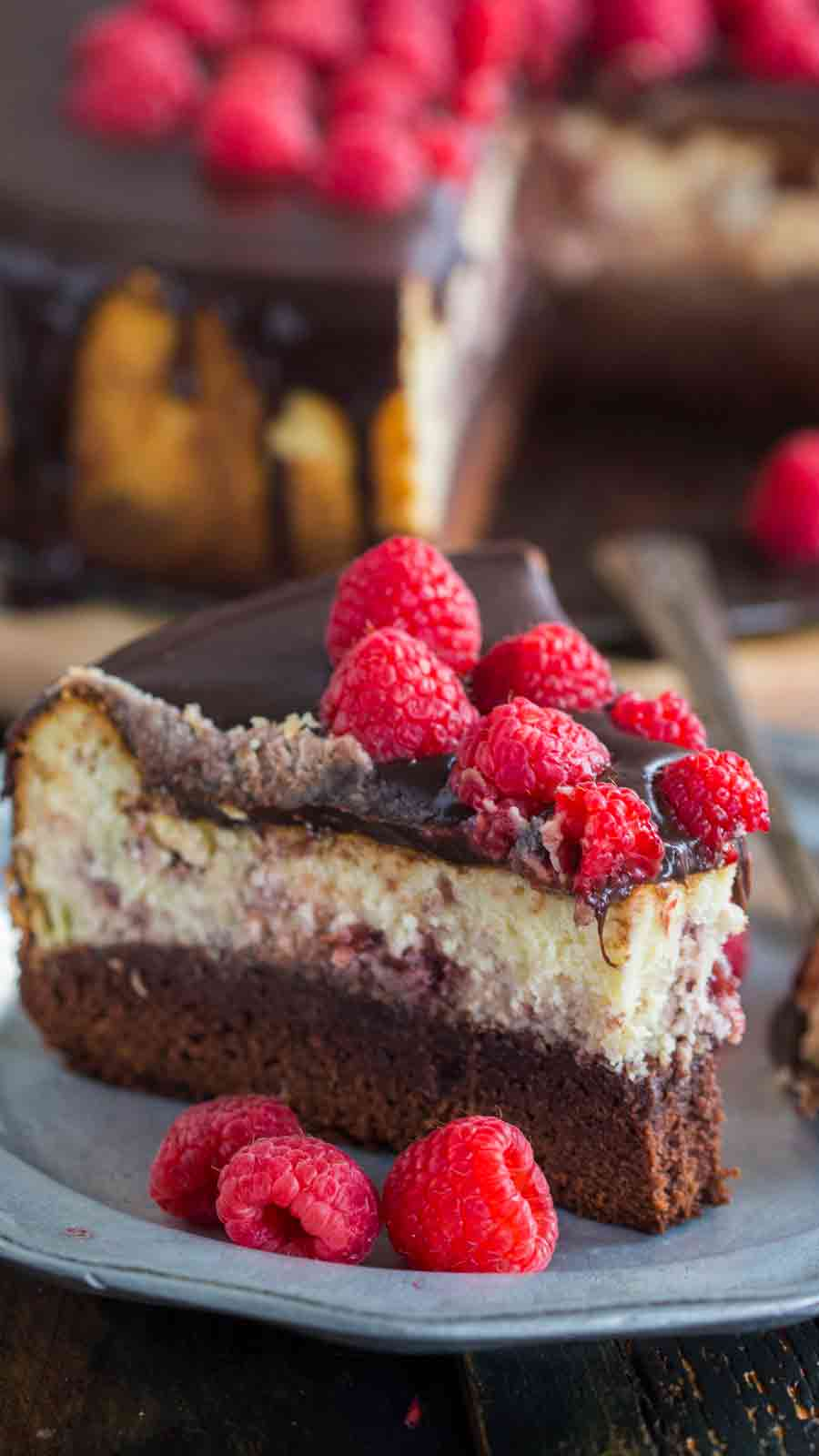 Brownie Bottom Raspberry Cheesecake is a showstopper dessert would be perfect for Valentine's Day! A brownie base topped with a creamy New York style cheesecake and a hefty amount of raspberry preserves.