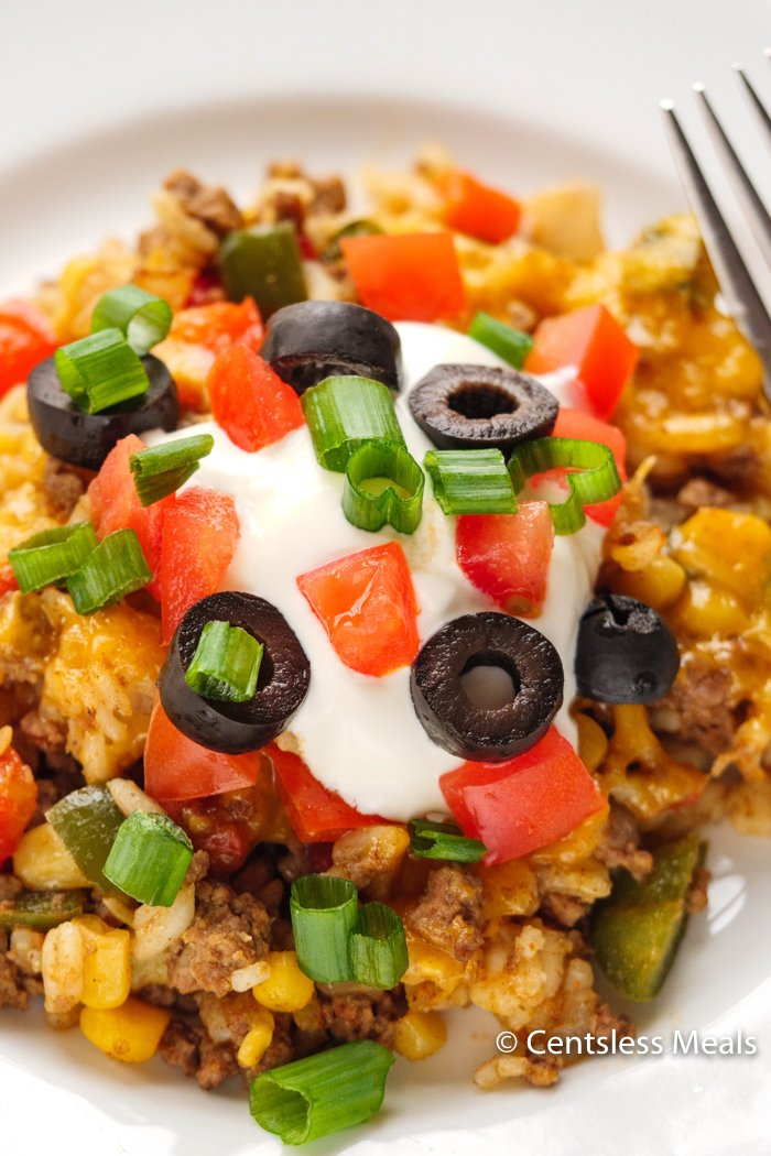 Easy Taco Casserole is made with spicy beef, rice, tomatoes, mexicorn, salsa and topped with loads of cheese. If want to mix things up try substituting the beef with chicken!