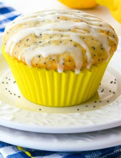 Glazed Lemon Poppy Seed Muffins On A White Plate