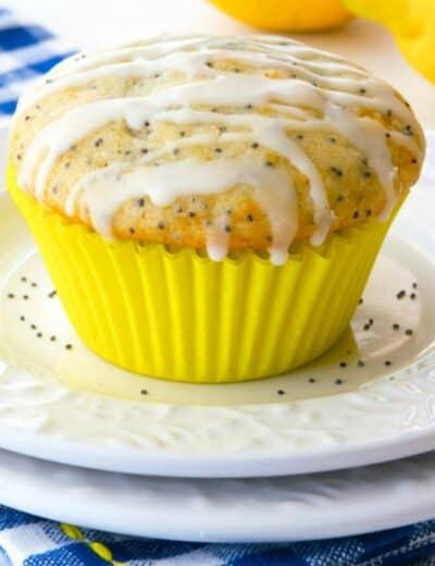 Glazed Lemon Poppy Seed Muffins On A White Plate