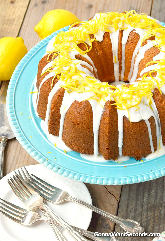Lemon Cream Cheese Pound Cake on a plate with forks and plates on the side