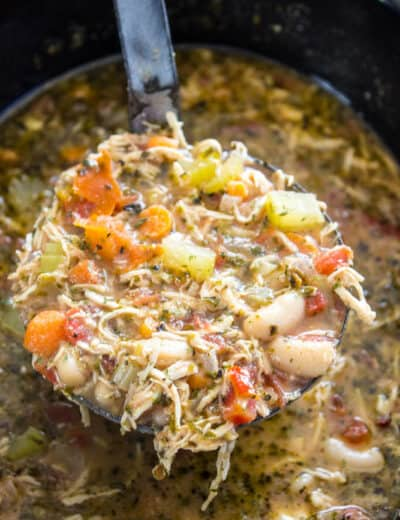 Slow cooker chicken soup with a ladle