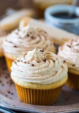 Tiramisu Cupcakes are a delicious take on the classic Italian dessert. Infused with a kahlua and espresso mixture and topped with mascarpone cream.