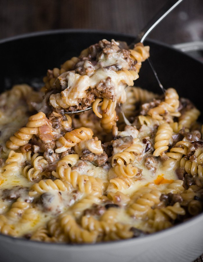 Cheeseburger pasta casserole in a pot with a spoon