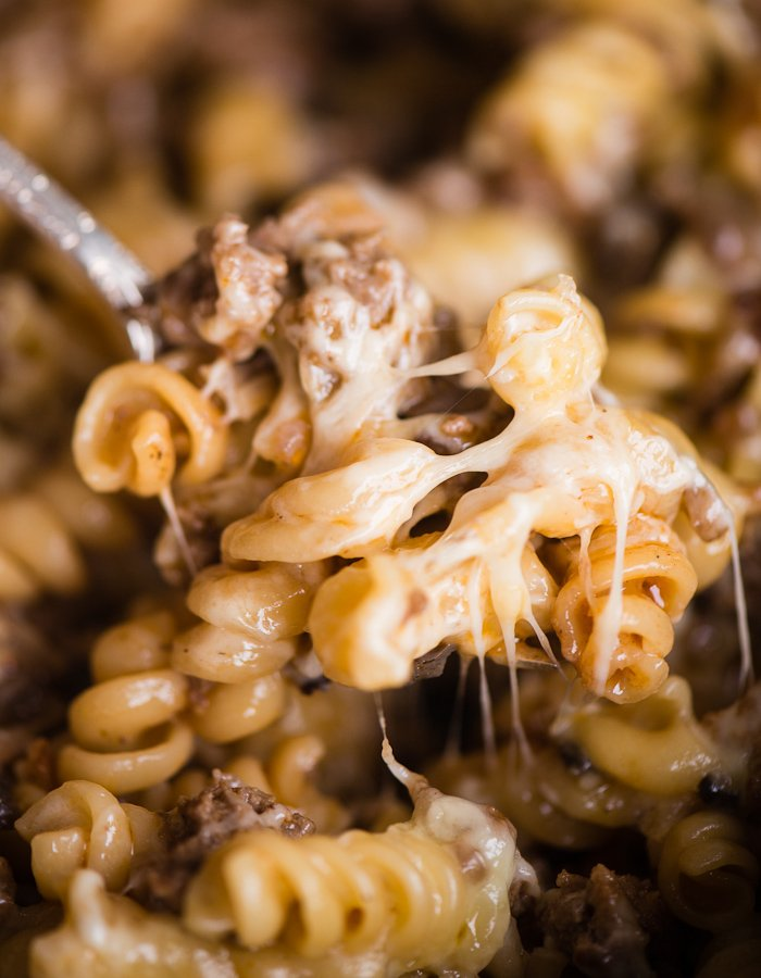 Cheeseburger pasta casserole with a spoon