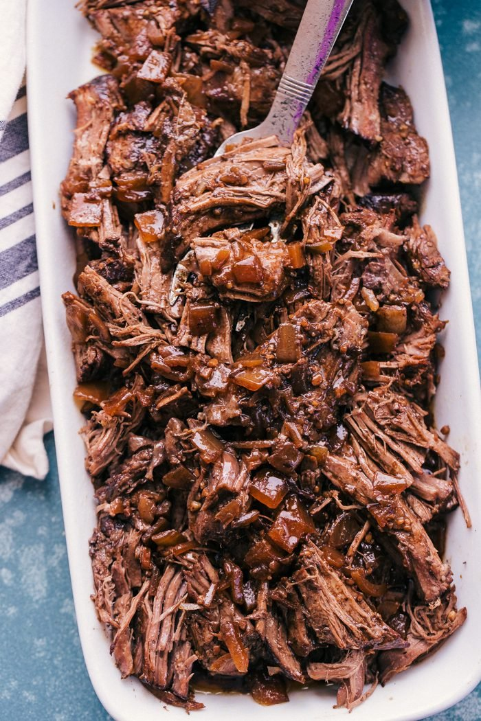 Slow cooker balsamic Roast Beef in a dish with a fork