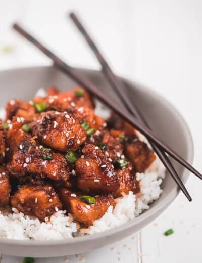 Instant pot honey garlic chicken garnished with green onion and sesame seeds